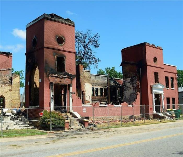 fire damage on brick building with structure falling apart